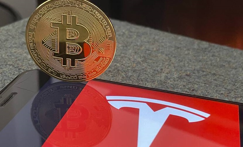 Tesla решила приостановить продажу авто за биткоины