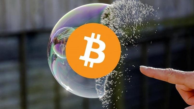 Джон Полсон считает криптовалюты пузырем
